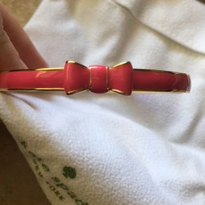 Kate Spade gold and pink bow bangle bracelet